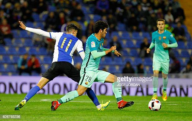 Hercules' forward Salinas vies with Barcelona's midfielder Carles Alena during the Spanish Copa del Rey round of 32 first leg football match Hercules...