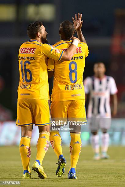 Hercules Gomez and Joffre Guerron celebrate after scoring the first goal during a match between Monterrey and Tigres UANL as part of 14th round...