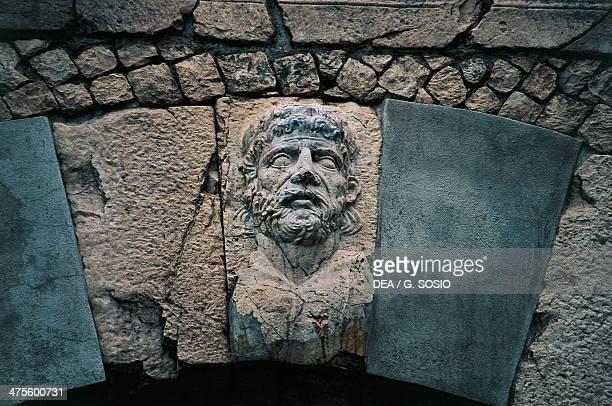 Hercules keystone decorated in relief Bojano Gate Saepinum Sepino Molise Italy Roman civilisation