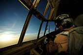 April 23, 2009 - A C-130 Hercules pilot scans the horizon during aeromedical operations in support of Operation Enduring Freedom.