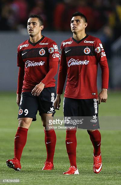 Herculez Gomez and Joe Corona of Club Tijuana look on after losing the first match of two in their CONCACAF Champions League Quarterfinal at StubHub...