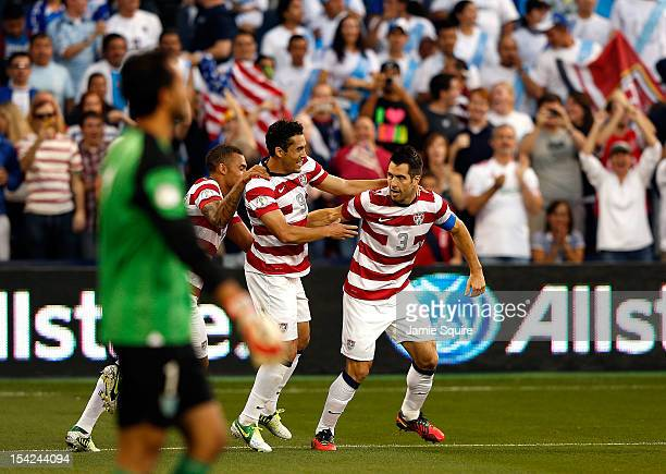 Herculez Gomez Danny Williams and Carlos Bocanegra of the USA celebrate after Bocanegra scored a goal during the first half of the World Cup...