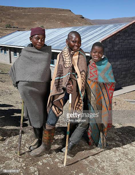 Herd boys pose for a photograph in front of the new herd boy school at the opening ceremony of the new Sentebale Mateanong Herd Boy School during a...