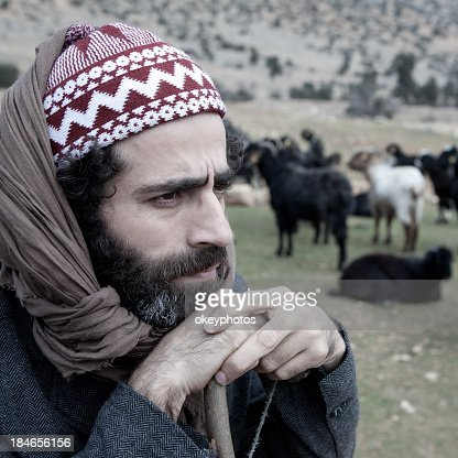 Herdsman watching his flock of sheep