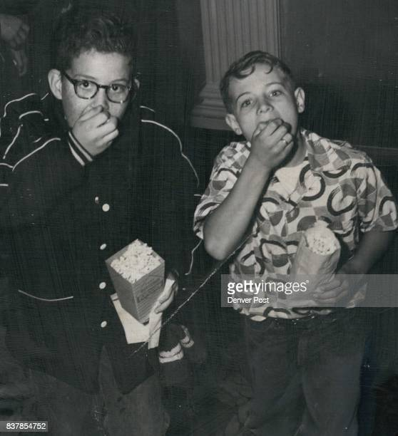 Here are two of The Denver Post's carrier boys entertained at the Denham theater for doing outstanding work on their routes Shown are Owen Novicoff...