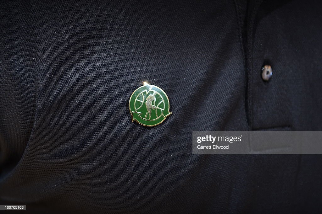Here is a close-up of an NBA Green Pin on someones shirt prior to The Dallas Mavericks versus the Denver Nuggets on April 4, 2013 at the Pepsi Center in Denver, Colorado.