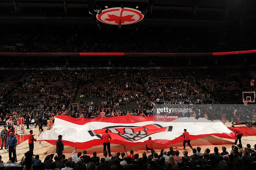 Here is a wide-angle photograph of the Toronto Raptors flag against the Miami Heat during the game on November 5, 2013 at the Air Canada Centre in Toronto, Ontario, Canada.