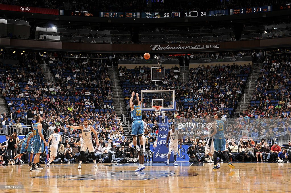 Here is a Wideangle shot of Brian Roberts #22 of the New Orleans Hornets shooting a deep three point shot against the Orlando Magic during the game on December 26, 2012 at Amway Center in Orlando, Florida.