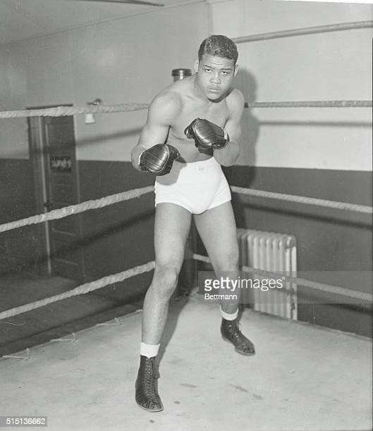 Here is 'Dead Pan' Joe Louis colored heavyweight boxing sensation who fights Primo Carnera former titleholder at the Yankee Stadium New York City...