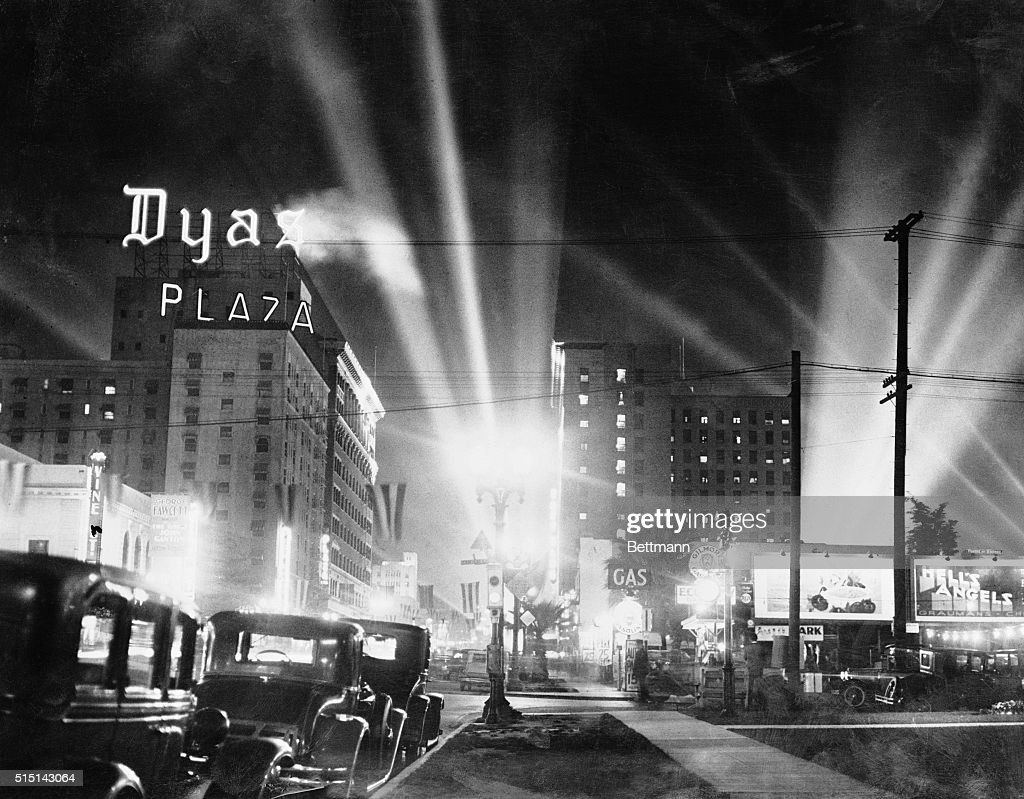 Here is Hollywood boulevard in the cinema capitol of America appears embazoned in electric lights during a premier of a new screen vehicle This one...