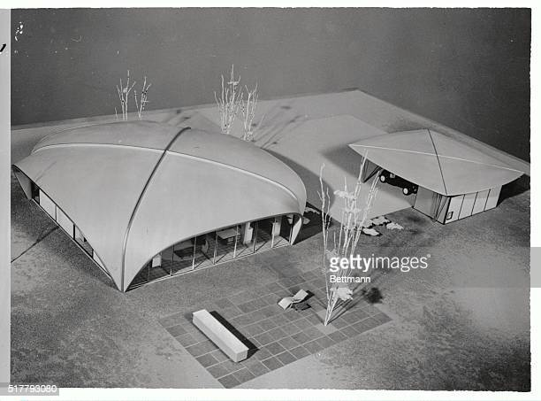 HOME OF TOMORROW Here is the allelectric house built almost entirely of prefabricated plastic panels in the shape of a porticoed dome which supports...
