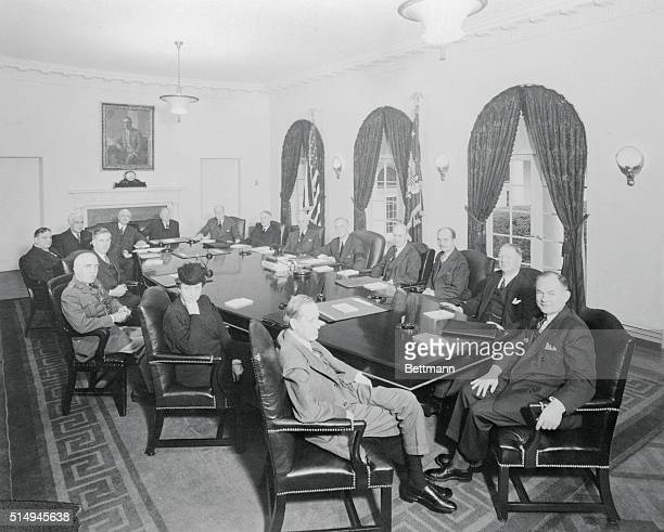 Here is the first picture of President Roosevelt seated with his 'war cabinet' which consists of his regular Cabinet in addition to the heads of the...