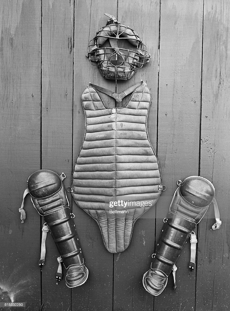 Here is the harness worn by a big league catcher It consists of face mask a padded affair of steel bars leather and stuffing a chest and body...