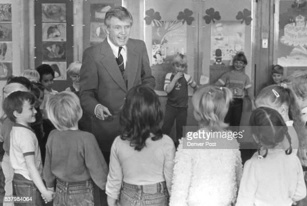 Here we have a shot of Mr Flieger with the kids having a little fun with them trying to figure out which kid is in line to receive a birthday sticker...