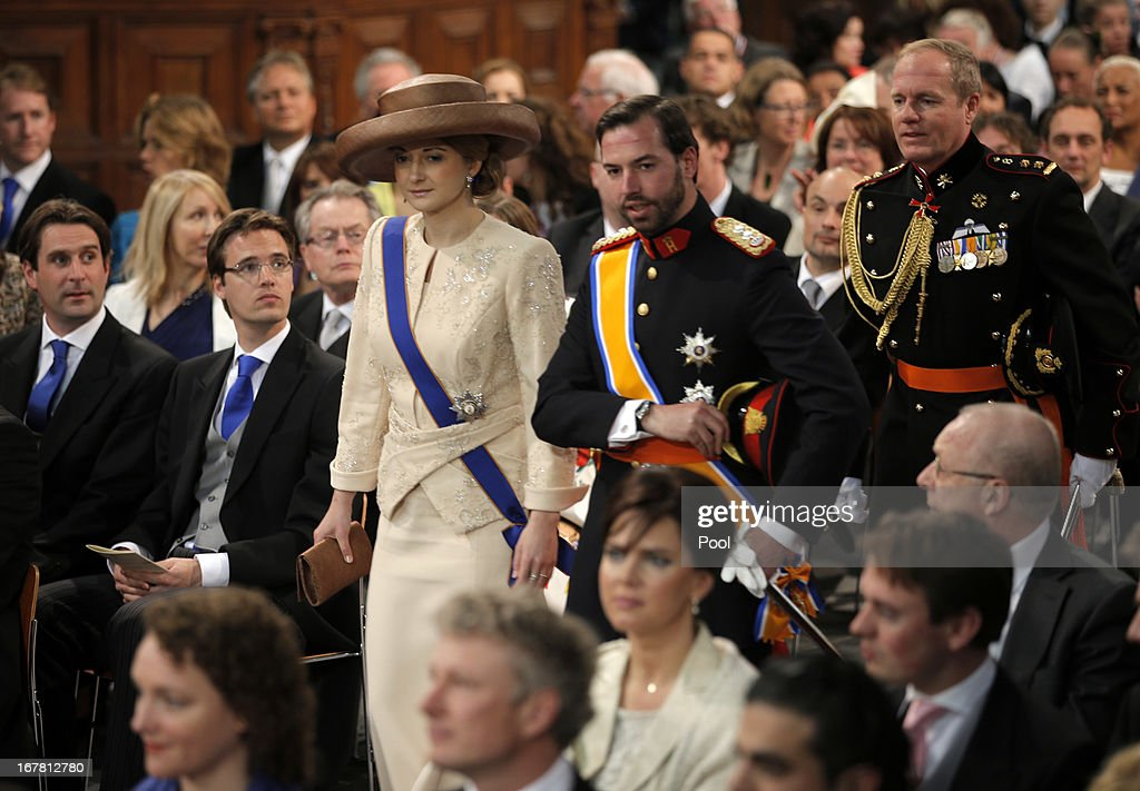 Hereditary Grand Duke Guillaume, and Hereditary Grand Duchess Stephanie of Luxembourg during the inauguration ceremony of King Willem Alexander and Queen Maxima of the Netherlands at New Church on April 30, 2013 in Amsterdam, Netherlands.