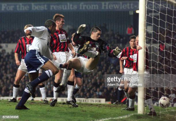 Hereford goalkeeper Chris MacKenzie looks behind as Tottenham's Chris Armstrong scores during this FA Cup third round replay match at White Hart Lane