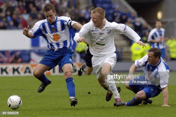 Hereford United's Andrew Ferrell is challenged by Halifax Town's Martin Foster during the Nationwide conference playoff Final at the Walkers Stadium...