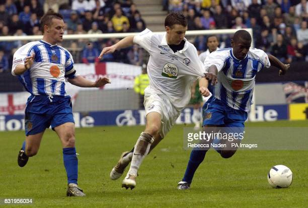 Hereford United's Andrew Williams challenges Halifax Town's Tyrone Thompson during the Nationwide conference playoff Final at the Walkers Stadium...