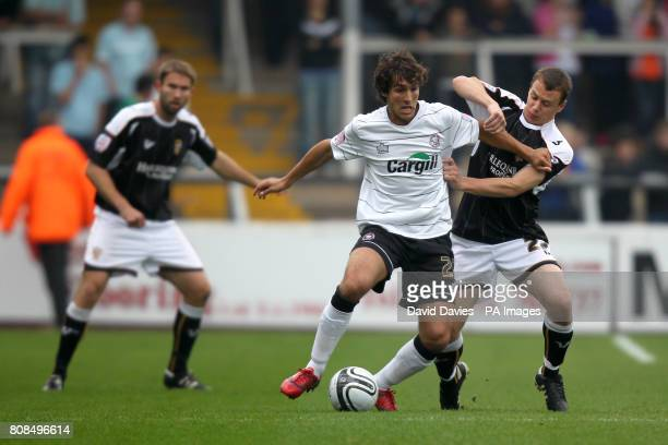 Hereford United's Guillem Bauza and Port Vale's Gary Roberts battle for the ball