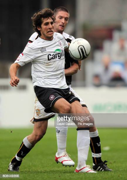 Hereford's Guillermo Bauza is under pressure from Port Vale's Gareth Owen during the npower League Two match at Edgar Street Hereford