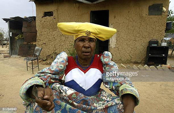 Herero woman pereres her lunch 12 November 2004 outside her home in Otjiwarongo 250km north of Windhoek With unemployment at between 3040 percent job...