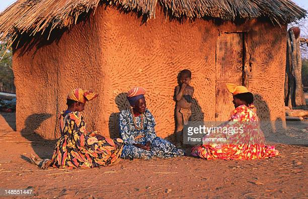 Herero women in typical Victorian dresses and hats, showing historical influence of German missionaries' wives.