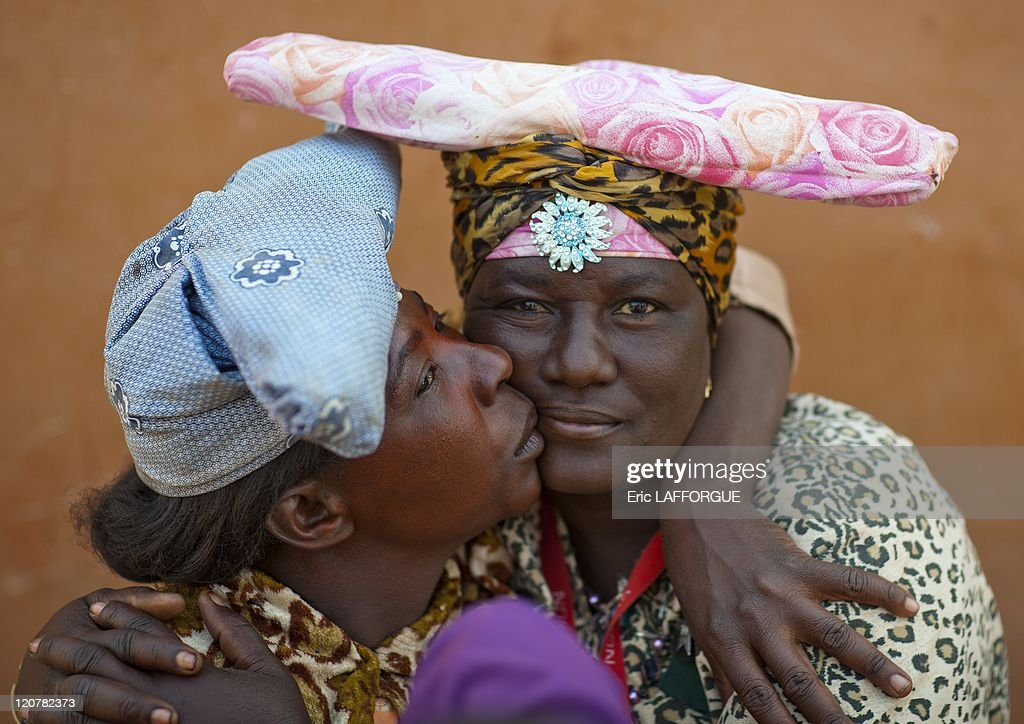 Herero Women Kissing in Opuwo Namibia on August 19 2010 The Hereros are an ethnic group belonging to the Bantu speaking group The 320000 Herero...