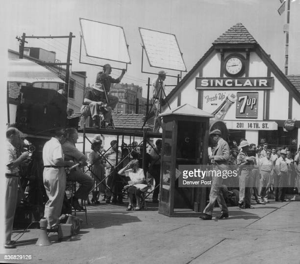 Here's another of the scenes filmed at the 'Civic Center filling station' Monday Stewart enters a telephone booth to call his girl friend played by...