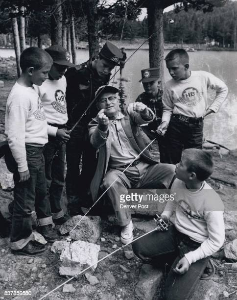 Here's How You Do It Fellows Denver Post Roving Fisherman Jim Haywood shows six of the Highlander Boys attending the organization's summer camp in...