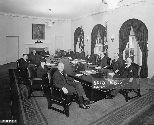 Here's the first picture of President Roosevelt seated with his present Cabinet Reading clockwise around the table Claude R Wickard Secretary of...