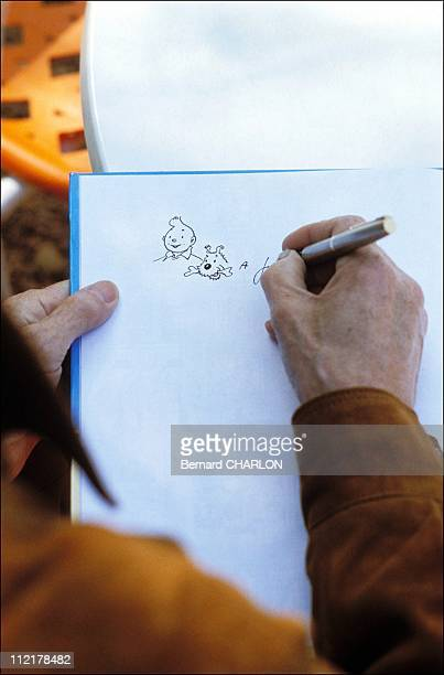 Herge draws Tintin the protagonist of his famous cartoon on May 131982 to celebrate his forthcoming 75th birthday in BrusselsBelgium