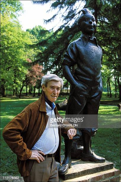 Herge stands in front of a Tintin statue on May 13 1982 in BrusselsBelgium