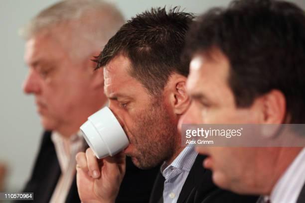 Heribert Bruchhagen former head coach Michael Skibbe and press officer Carsten Knoop attend a press conference of Eintracht Frankfurt at the...