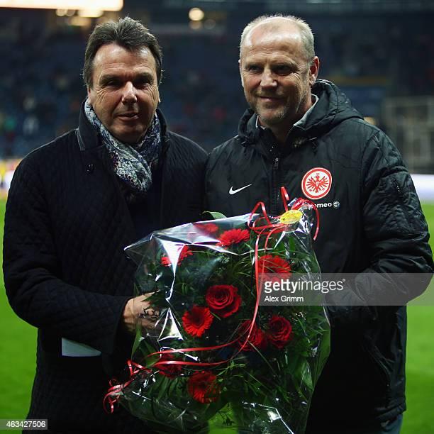 Heribert Bruchhagen of Frankfurt congratulates head coach Thomas Schaaf for his 500th Bundesliga match prior to the Bundesliga match between...