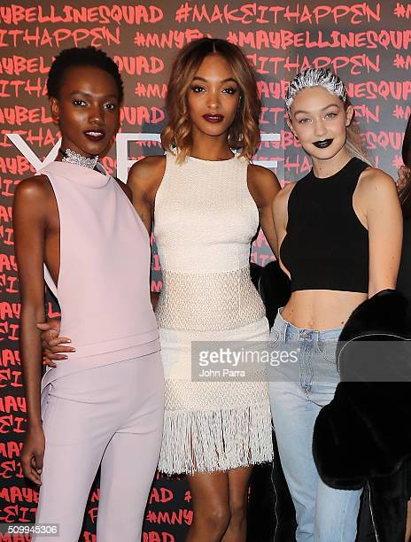 Herieth Paul Jourdan Dunn and Gigi Hadid attend Maybelline New York celebrates fashion week at Dream Downtown Hotel on February 12 2016 in New York...