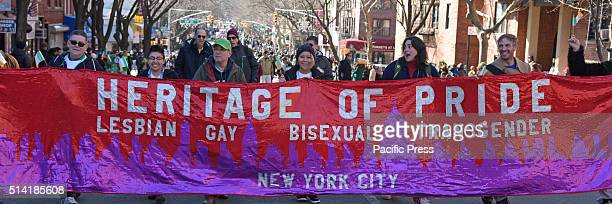 Heritage Of Pride members march behind banner Mayor Bill de Blasio and members of the NYC city council marched in Sunnyside's annual St Pat's For All...