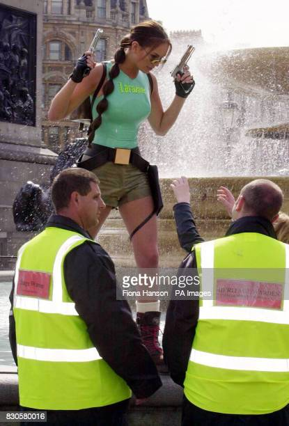 Heritage wardens with Lucy Clarkson the official model for the Tomb Raider cartoon heroine Lara Croft in Trafalgar Square where she and...