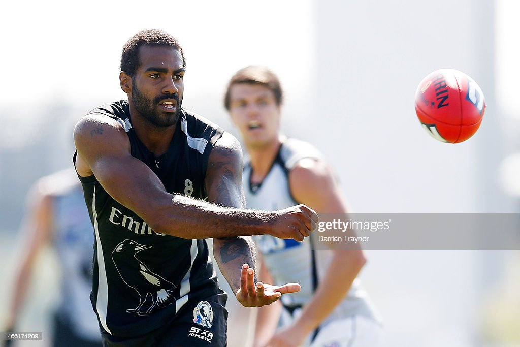 Heritier Lumumba handballs during a Collingwood Magpies AFL pre-season intra-club match at Olympic Park on February 1, 2014 in Melbourne, Australia.
