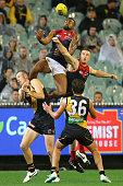 Heritier Lumumba of the Demons attempts to mark over the top of Jack Riewoldt of the Tigers during the round four AFL match between the Richmond...