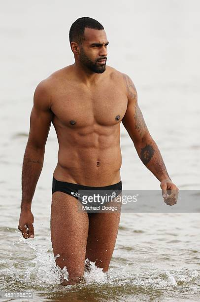 Heritier Lumumba of the Magpies walks out of the water during a Collingwood Magpies AFL recovery session at St Kilda Beach on July 14 2014 in...