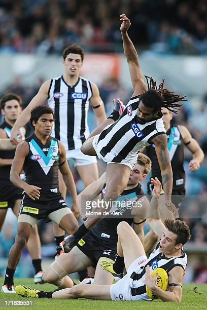 Heritier O'Brien falls over teammate Paul Seedsman during the round 14 AFL match between Port Adelaide Power and the Collingwood Magpies at AAMI...