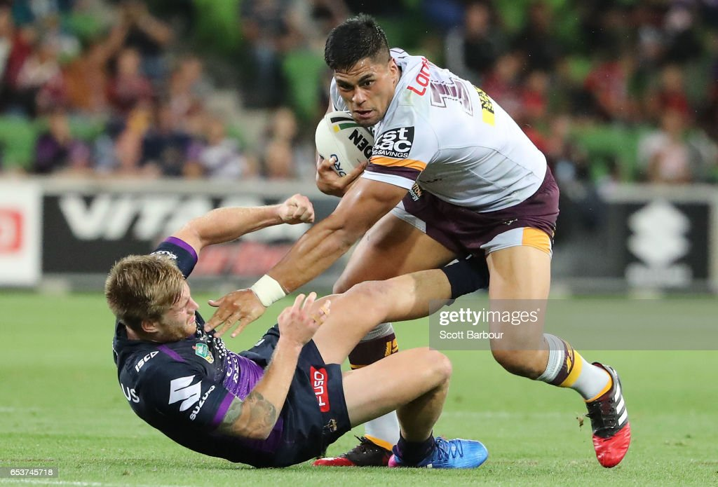 Herman Ese'ese of the Brocos is tackled by Cameron Munster of the Melbourne Storm during the round three NRL match between the Melbourne Storm and the Brisbane Broncos at AAMI Park on March 16, 2017 in Melbourne, Australia.