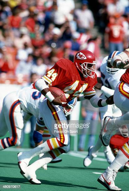 Herman Heard of the Kansas City Chiefs carries the ball against the Denver Broncos during an NFL Football game October 27 1985 at Arrowhead Stadium...