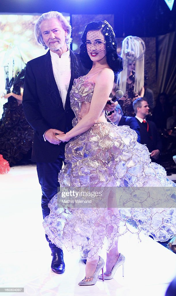 Hermann Buehlbecker and Dita von Teese, wearing creations out of Cake packagins by artist Larisa Katz Art couture, attend the Lambertz Monday Night at Alter Wartesaal on January 28, 2013 in Cologne, Germany.