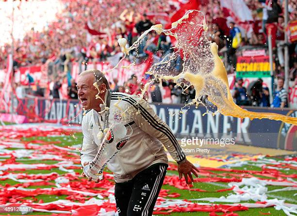 Hermann Gerland assistant coach of Bayern Muenchen is showered with beer as he celebrates the Bundesliga title after the Bundesliga match between...