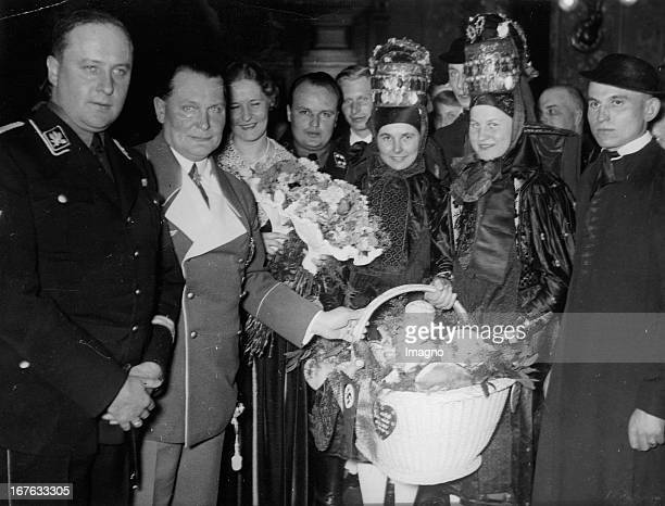 Hermann Goering and his wife Emmi Sonnemann received a delegation of farmers These convey their congratulations to the couple To see The bride and...