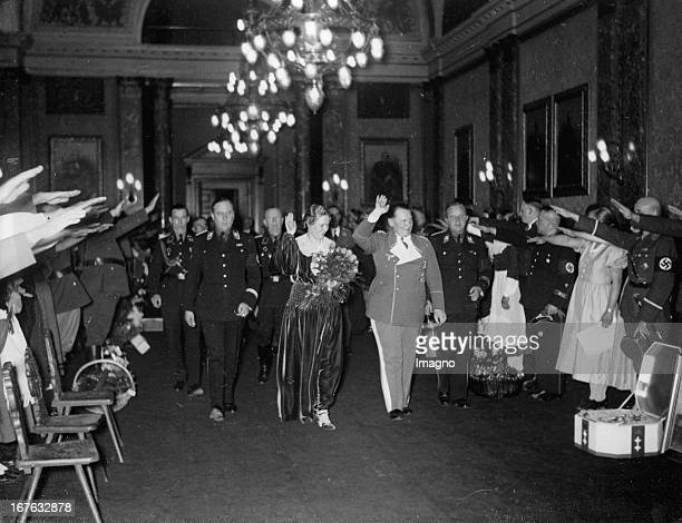 Hermann Göring with his wife Emmy Sonnemann on the day before their wedding Left Minister Walter Darré Preußenhaus/Berlin April 9th 1935 Photograph...