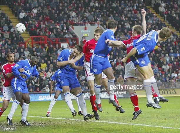 Hermann Hreidarsson of Charlton battles with John Terry of Chelsea to scores their first goal during the FA Barclaycard Premiership match between...