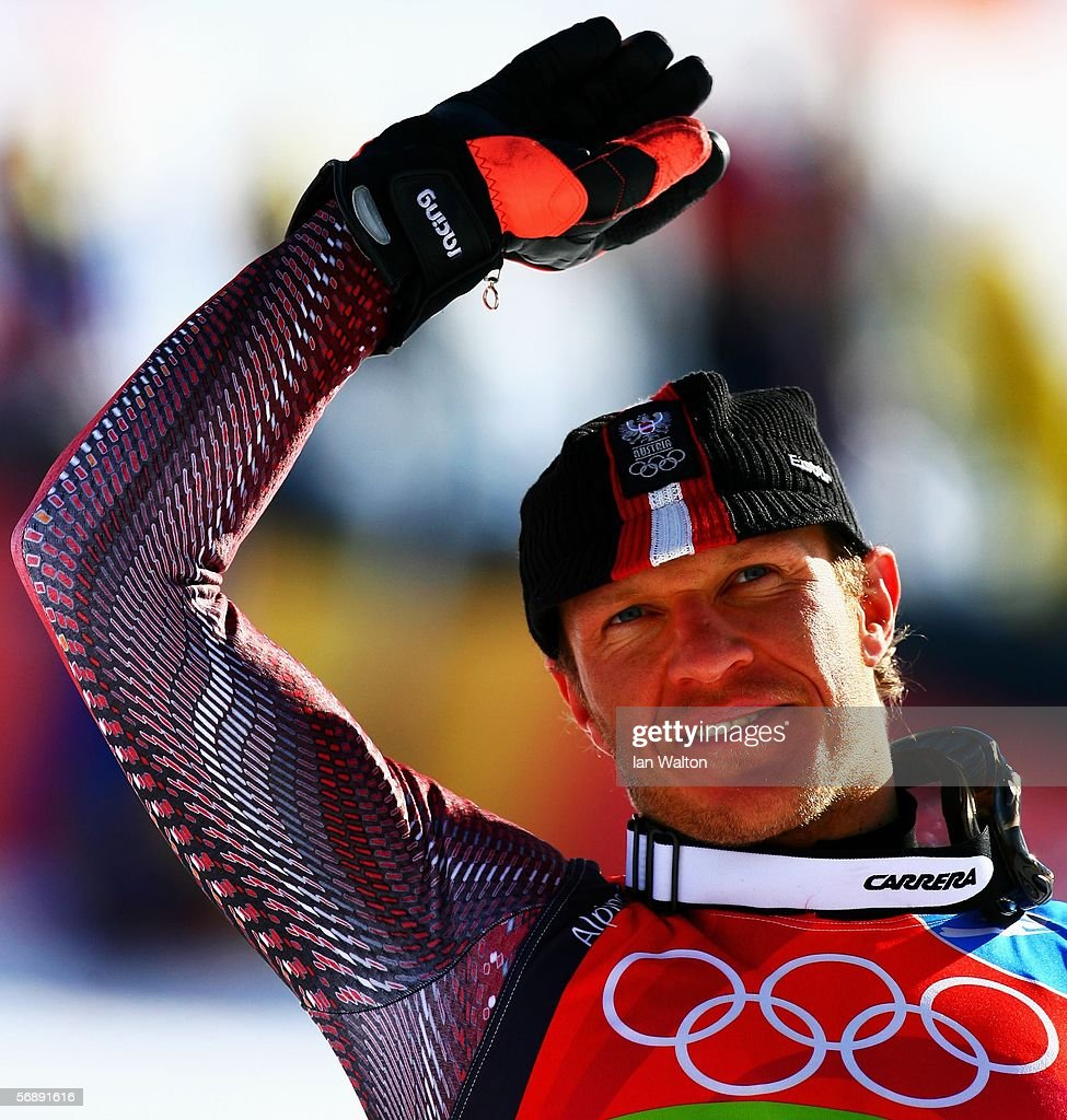 Hermann Maier of Germany celebrates winning his Bronze Medal at the Flower Ceremony after the Mens Alpine Skiing Giant Slalom competition on Day 10...