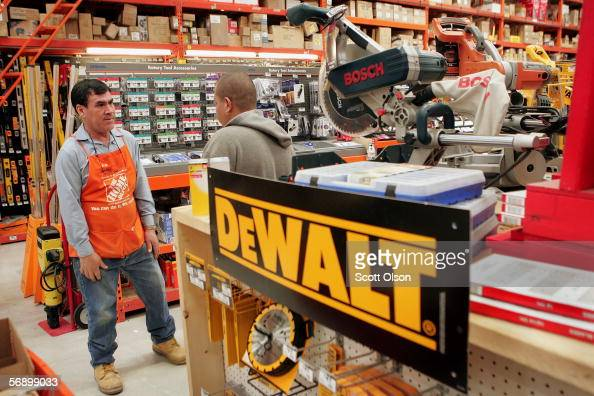 Hermen Davalos helps a customer at a Home Depot store in February 21 2006 in Chicago Illinois Home Depot the nation's largest home improvement store...